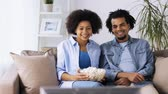 pipoca : smiling couple with popcorn watching tv at home