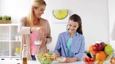 seasonings : happy family cooking salad at home kitchen