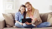mão humana : family with tablet pc having video chat at home Stock Footage