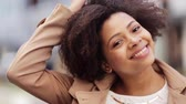 black hair : close up happy african american woman outdoors Stock Footage