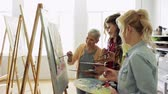 quadro : women with brushes painting at art school