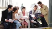 university : international business team with papers outdoors