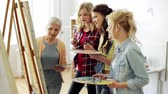 artists canvas : women with brushes painting at art school