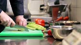 aipo : hands of male chef cook chopping celery in kitchen