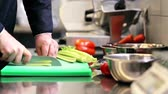 organický : hands of male chef cook chopping celery in kitchen