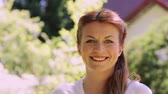 propriedade : portrait of happy smiling redhead woman outdoors Stock Footage