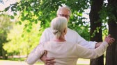 жена : happy senior couple dancing at summer city park