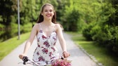 fixní : happy young woman riding bicycle in summer park