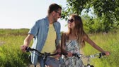 bicyklista : happy young couple with bicycles in summer