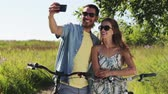 j��zda na kole : couple with bicycle taking selfie by smartphone