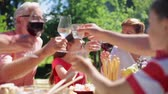 grandchildren : happy family having dinner or summer garden party Stock Footage