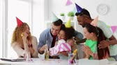 wish : team greeting colleague at office birthday party Stock Footage