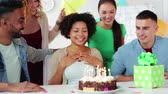 making a wish : team greeting colleague at office birthday party Stock Footage