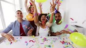 blower : happy team throwing confetti at office party Stock Footage