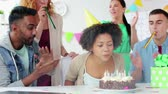 blower : team greeting colleague at office birthday party Stock Footage