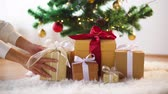 sheepskin : hands taking gift boxes from under christmas tree Stock Footage