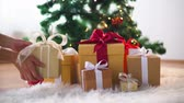 hands taking gift boxes from under christmas tree Stock Footage