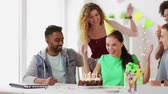 celebração : team greeting colleague at office birthday party Stock Footage