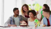 team greeting colleague at office birthday party Stock Footage
