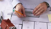 dimensão : architect hands with ruler measuring blueprint