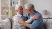 cônjuge : sad senior couple hugging at home Stock Footage
