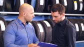 roda : customer and salesman at car service or auto store