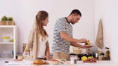 pasta dishes : happy couple cooking and serving food at home