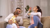 blower : happy family with baby and soap bubbles at home Stock Footage