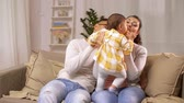 parentalidade : happy family with baby girl at home Stock Footage