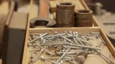 ferramentas : wood screws and tools in box at workshop