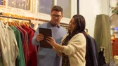 aquisitivo : couple with tablet pc at vintage clothing store Stock Footage