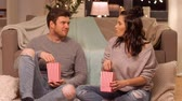 pipoca : happy couple eating pop corn at home