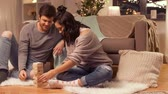 parabéns : happy couple playing block-stacking game at home