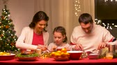 molho : happy family having christmas dinner at home
