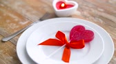 em forma de : close up of red heart shaped lollipop on plate Stock Footage
