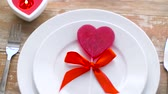 arco : close up of red heart shaped lollipop on plate Vídeos
