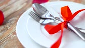 talher : close up of cutlery tied with red ribbon on plate