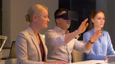 augmented reality : team with virtual reality headset at night office