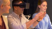adultos : team with virtual reality headset at night office