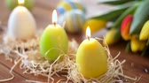 tulip : candles in shape of easter eggs and flowers Stock Footage