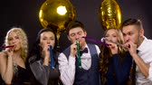 blower : happy friends with balloons and party blowers Stock Footage