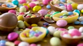 nobody : chocolate easter eggs and drop candies on table Stock Footage