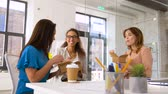 takeout : happy businesswomen eating take out food at office Stock Footage