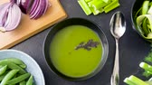 seler : close up of vegetable green cream soup in bowl