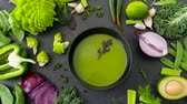 kurs : close up of vegetable green cream soup in bowl
