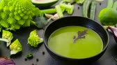 green onion : close up of vegetable green cream soup in bowl