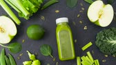 натюрморт : bottle with green juice and vegetables on table Стоковые видеозаписи