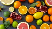 натюрморт : close up of citrus fruits on stone table