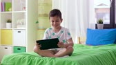 jogador : smiling boy with tablet pc computer at home Stock Footage