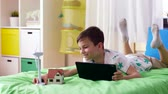 electricity : boy with tablet pc and wind turbine toy at home